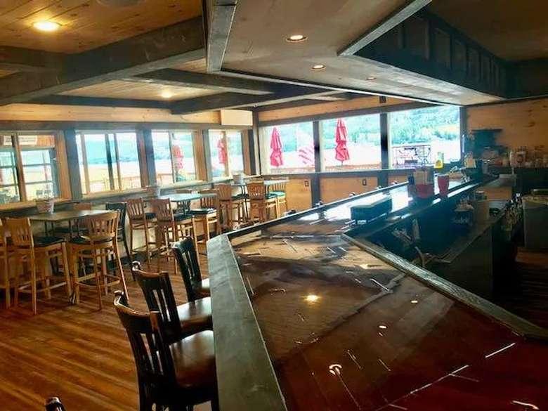 tables and a bar inside a restaurant