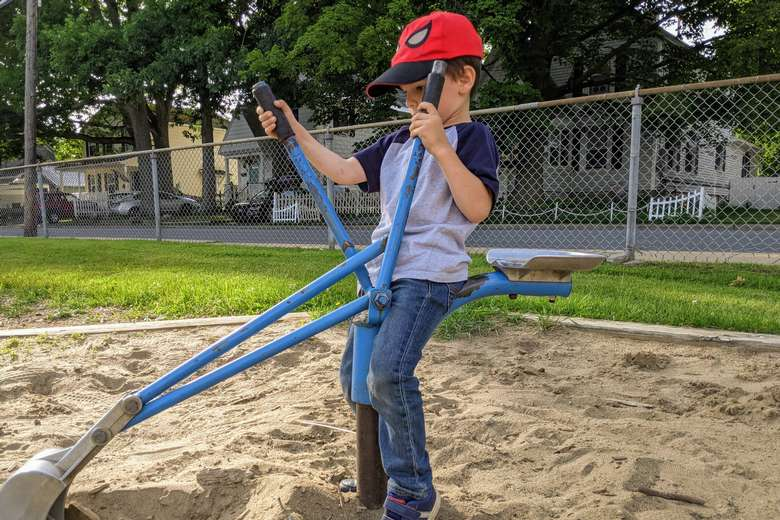 boy plays with digger equipment