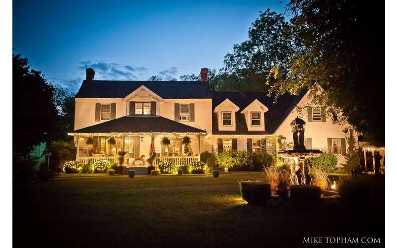 The house and grounds are magically illuminated at night. Photo by Mike Topham Photography