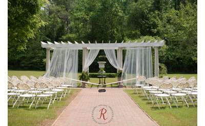 Our garden pergola can be decorated with drapes, flowers, etc. Photo by Rowlands Photography