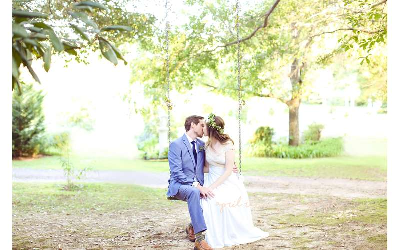 Our bridal swing is a perfect photo opp for your big day! Photo by April Renee Photography