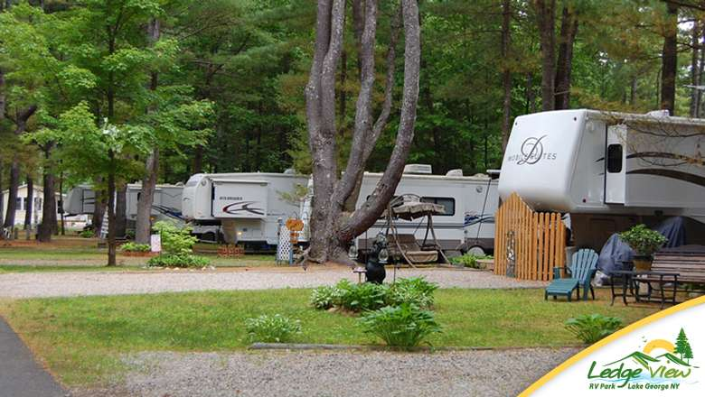 a row of RVs situated in separate campsites