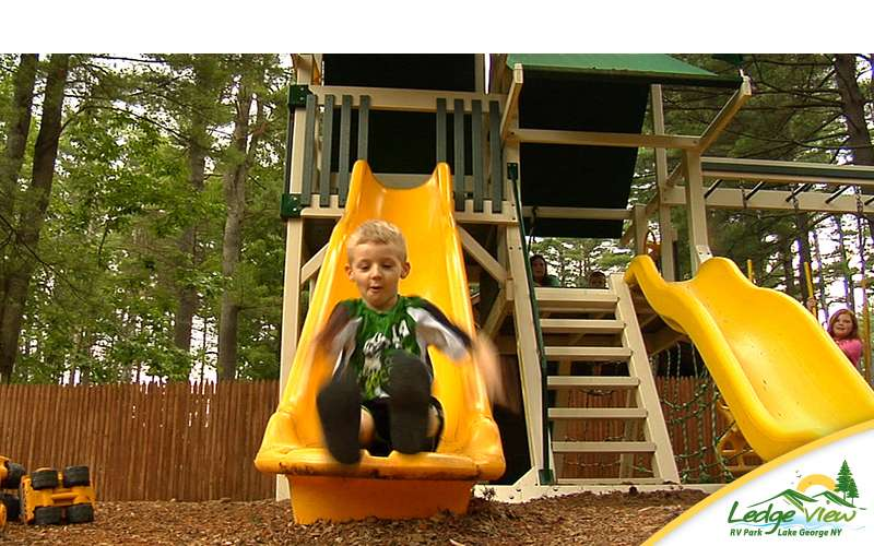 Bring the kids over to the playground area where there are slides and more.