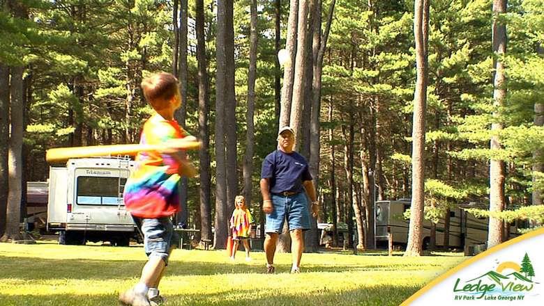 a boy getting ready to swing a baseball bat at a ball