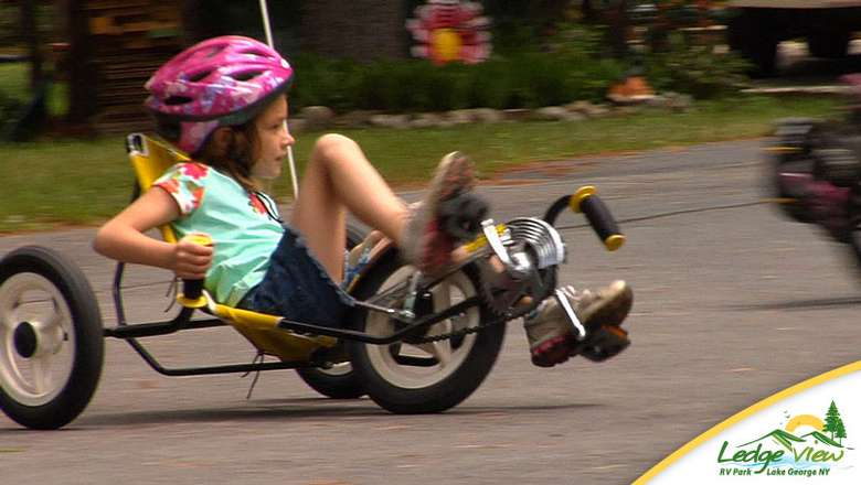 a girl taking a ride on a fun cycle