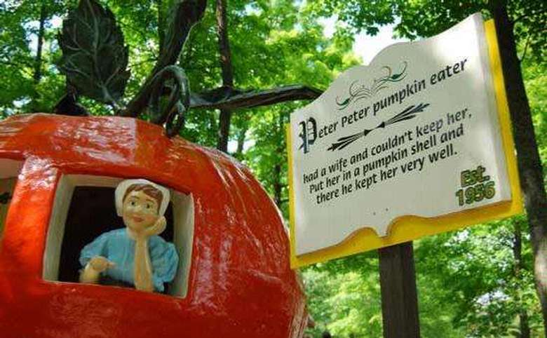 orange peter pumpkin eater house with sign
