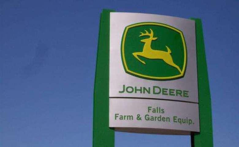 a john deere sign at fall farm and garden company