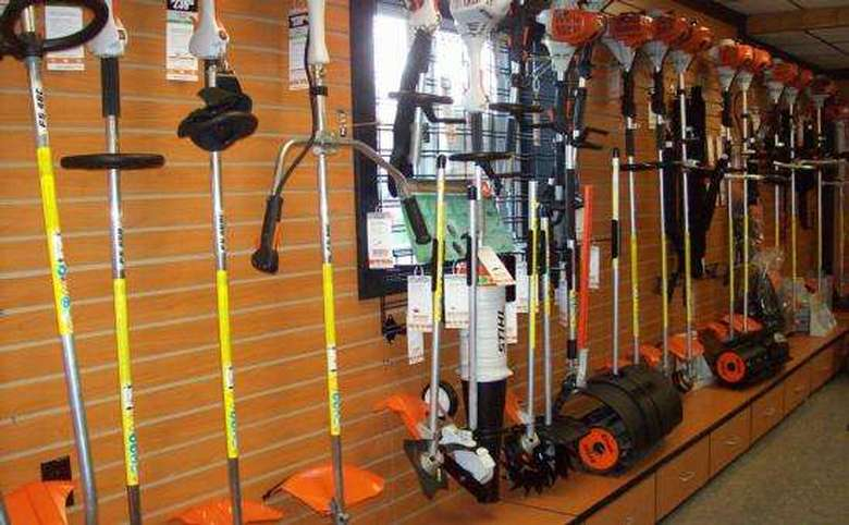 a variety of garden tools and equipment on a wall