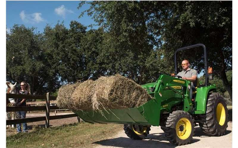 need a way to carry hay around the farm buy a compact tractor at falls farm garden - Falls Farm And Garden