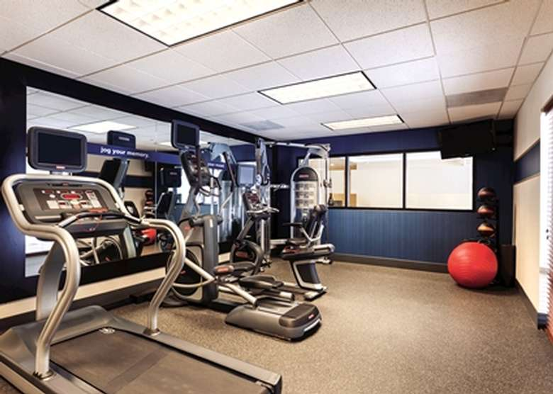 fitness center with treadmill and exercise machines