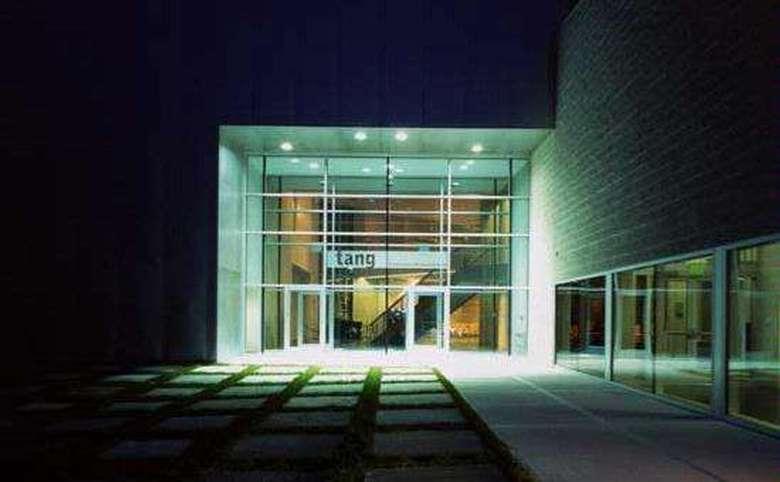 main entrance of the tang museum at night