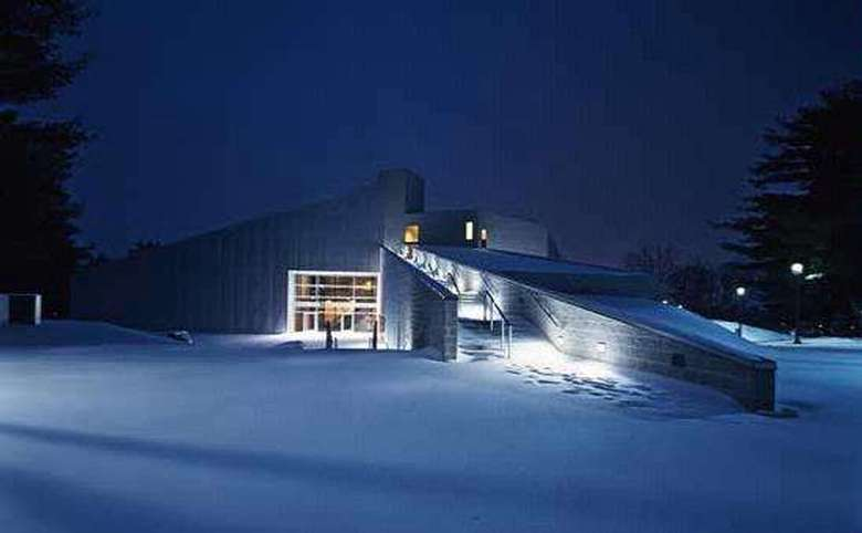 exterior of the tang museum in the winter at night