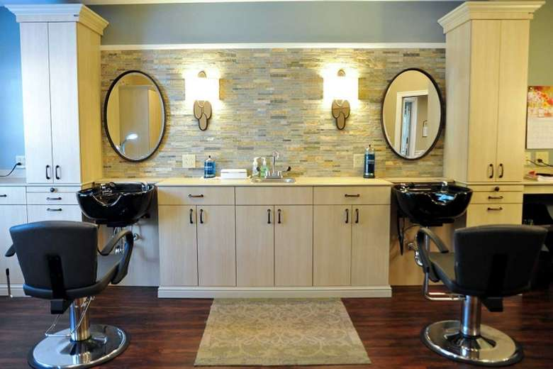salon with oval mirrors and chairs