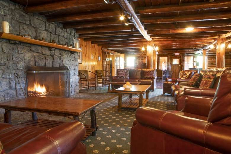 a spacious lobby in a rustic lodge