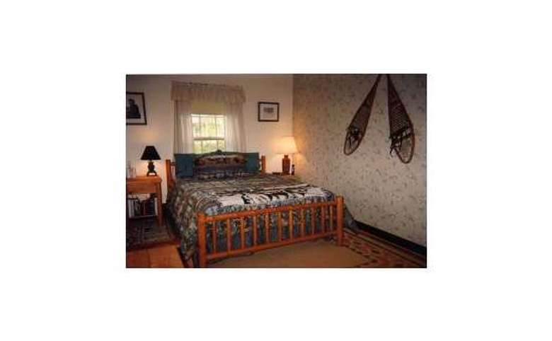 king-sized bed in a wooden frame