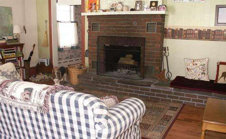 plaid couch in front of a fireplace in a sitting room
