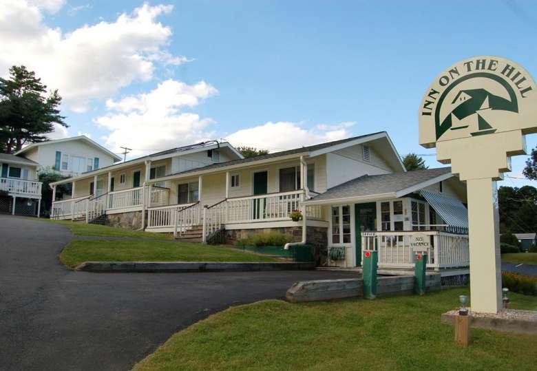 inn on the hill sign near a hotel