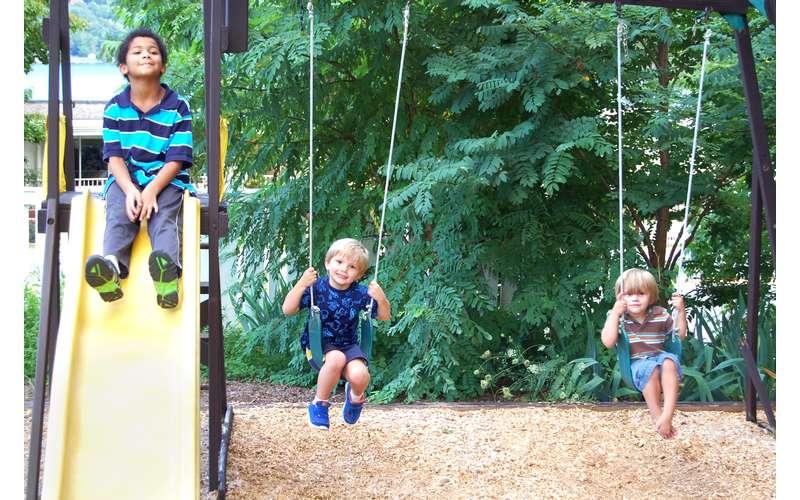 kids on swings and a slide