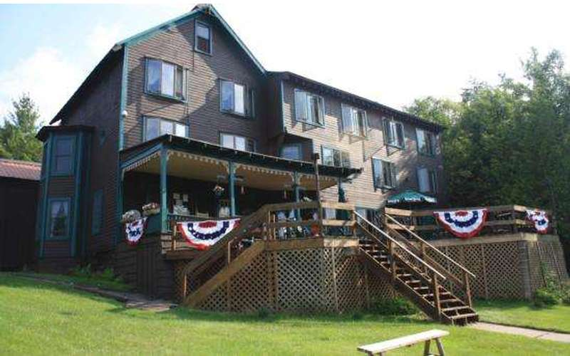 Large deck overlooking Big Moose Lake - Outdoor Dining