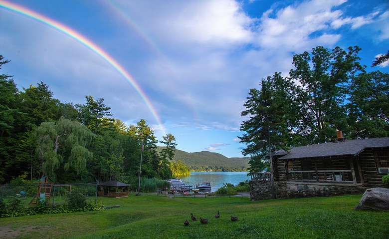 a rainbow in the sky on the resort property