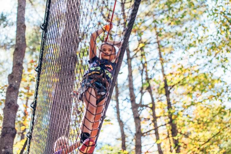 girls climbing up a rope net