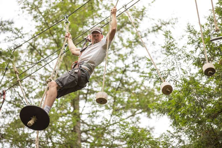 Man on the disk obstacle at Adirondack Extreme
