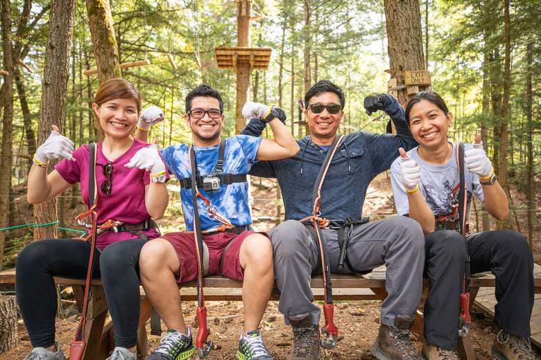 Group giving Adirondack Extreme's obstacle course a thumbs up