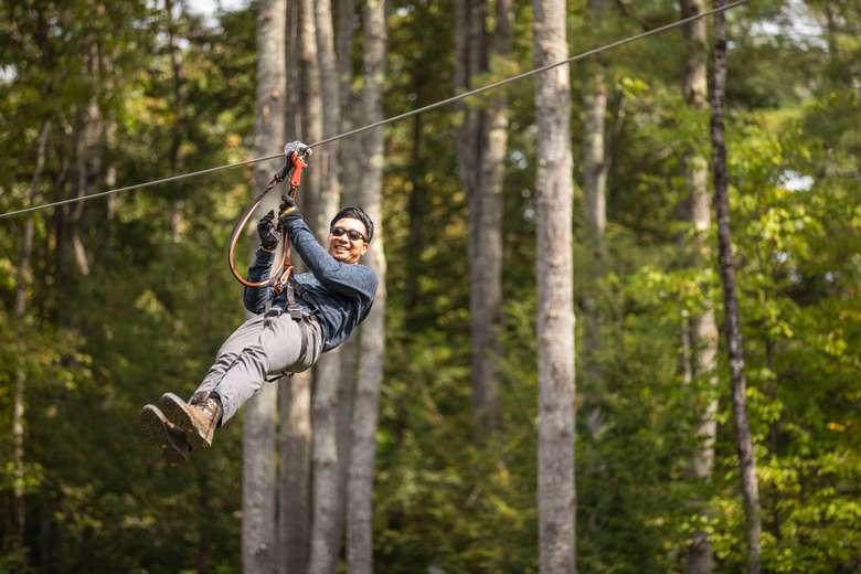 Man on giant zipline at Adirondack Extreme