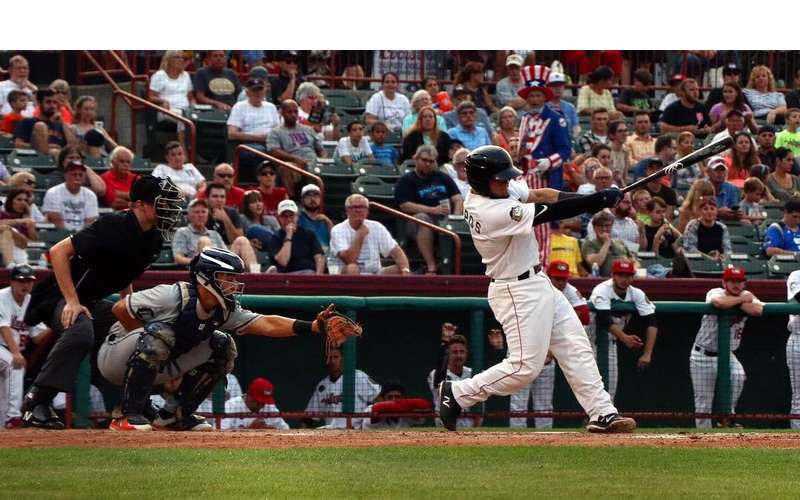 man swinging baseball bat