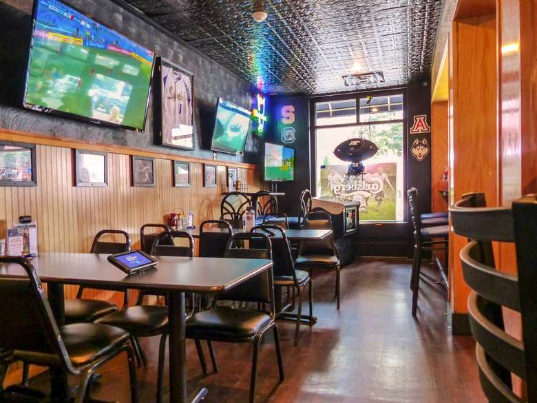 low dining tables with tvs on the walls