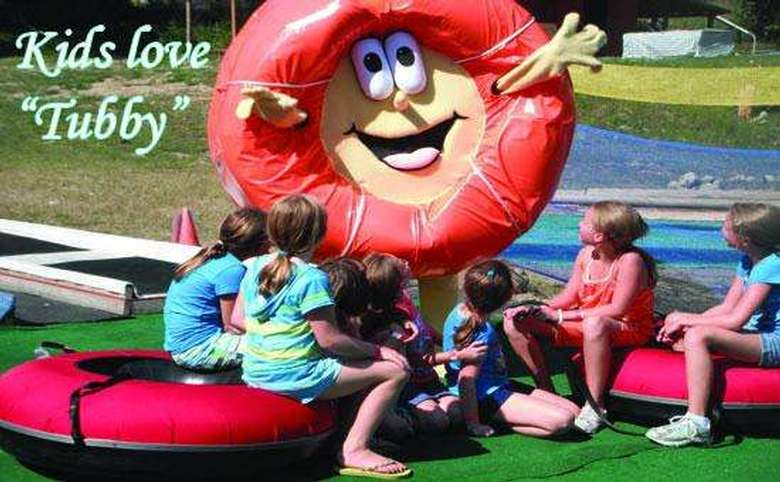person dressed as an inner tube character entertaining a group of girls