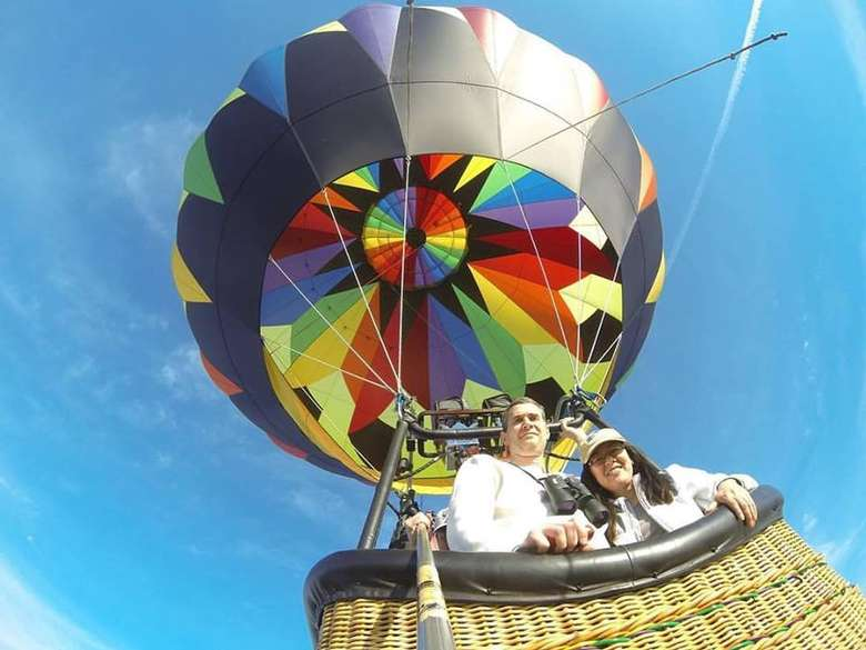 view of two people in a hot air balloon