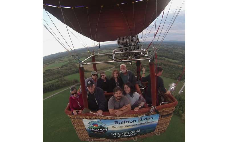 group of people in a hot air balloon basket