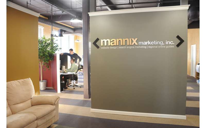 the logo for mannix marketing on a small wall