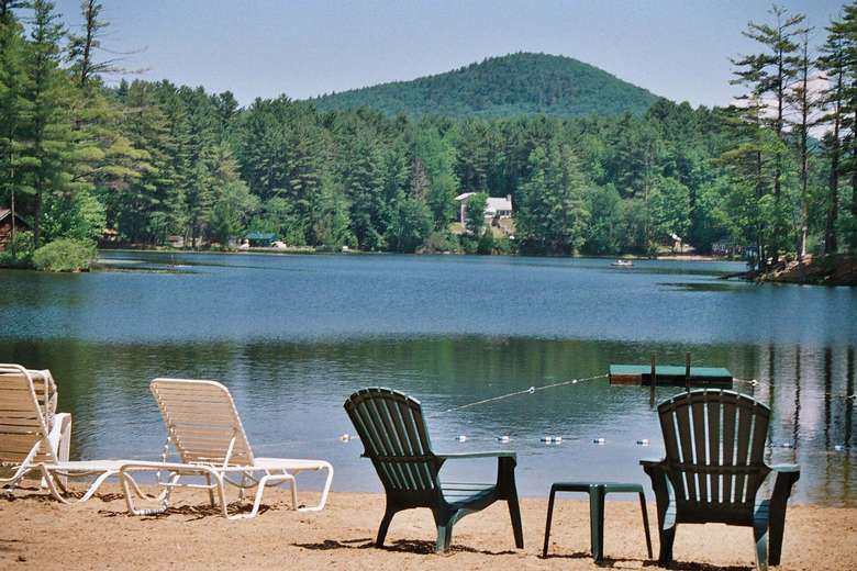 view of the lake from a beach with chairs