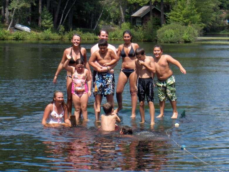 people posing and having fun in the lake