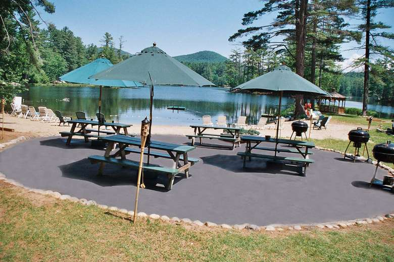 an area of picnic tables and grills