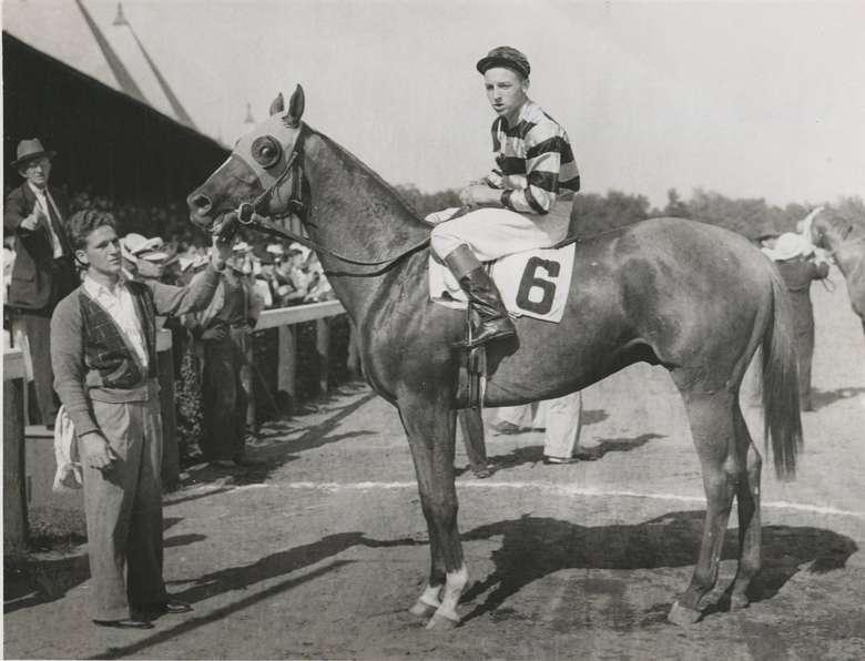 historic photo of a jockey atop a horse