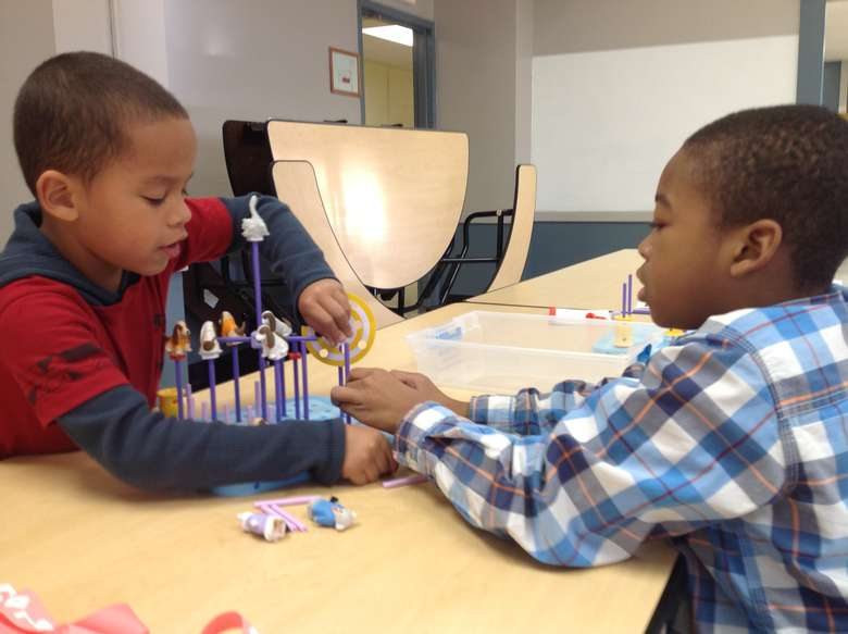 Two boys playing an animal themed game
