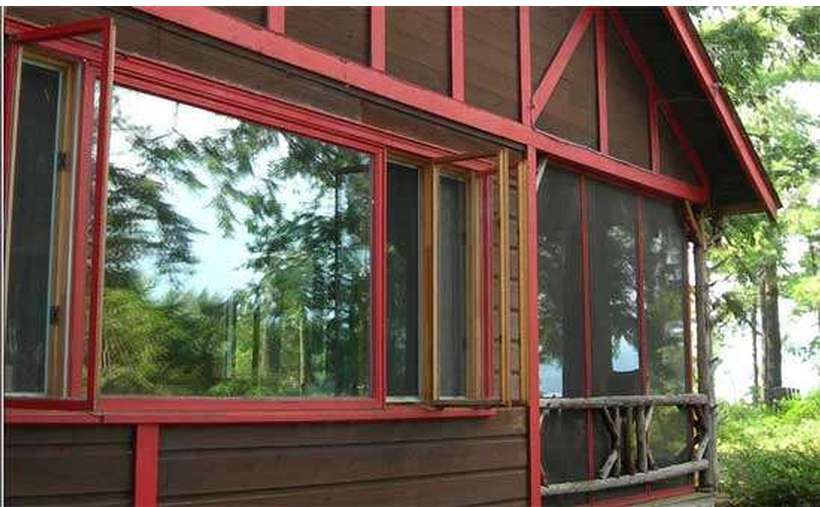 Four Bedrooms (Sleep Six)  with Screened in Porch, Stone Terrace and Barbeque Pit  -  Private Dock with 2 Car Parking