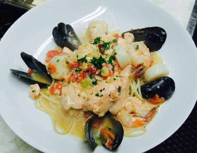 seafood pasta dish with mussels, shrimp, and fish