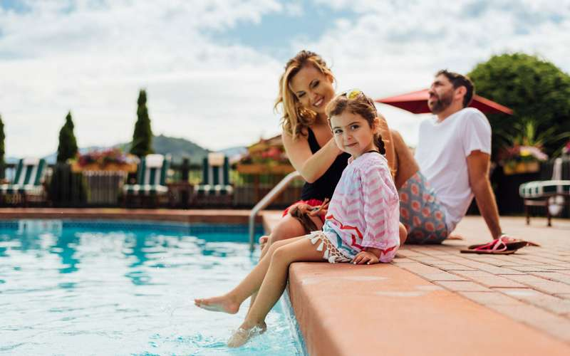 Family at courtyard pool.