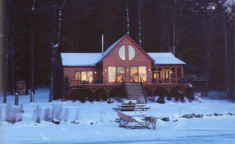 exterior view of a log home in the winter
