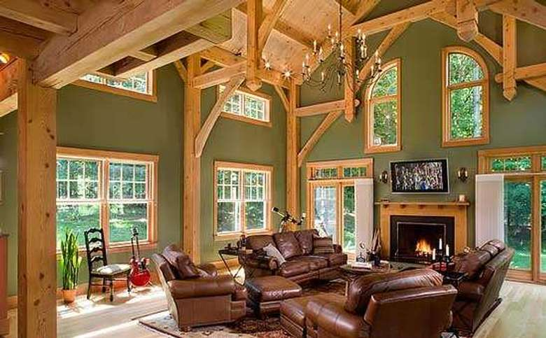 great room with high ceilings and wooden accents