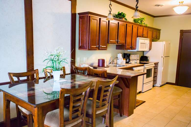 dining table and full kitchen with stove, dishwasher and refrigerator