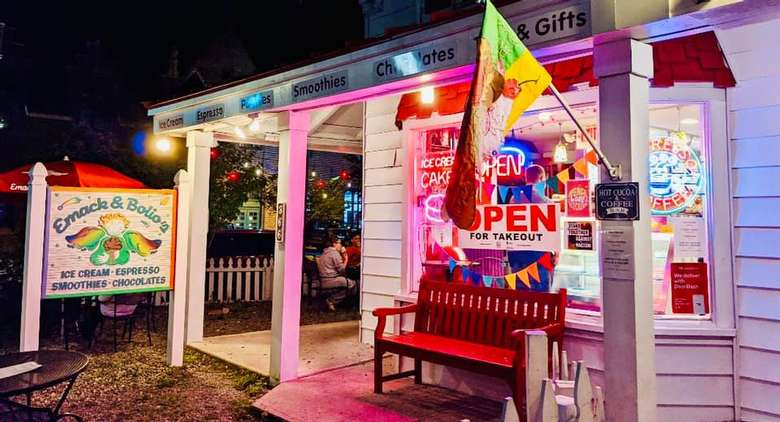 outside of a white and red ice cream shop at night