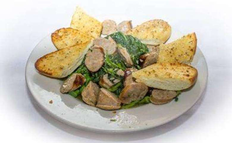 salad with sliced sausage and garlic bread