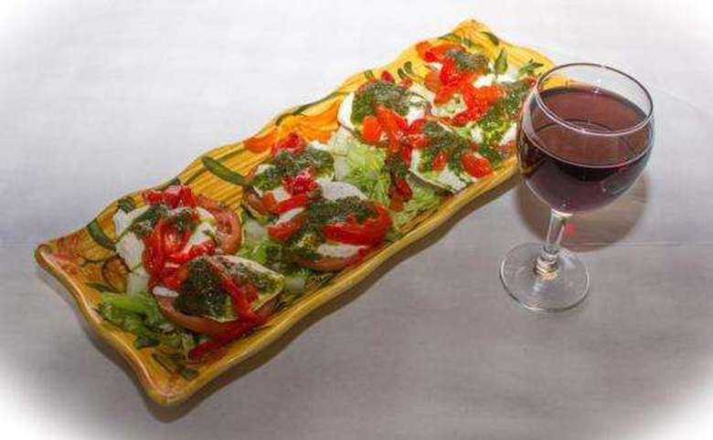 caprese salad with a glass of red wine