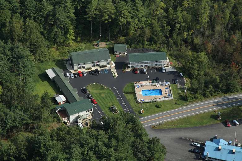 aerial view of a motel surrounded by trees
