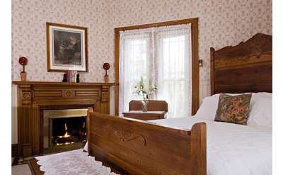 Rose Room bedroom with fireplace, 1890 building